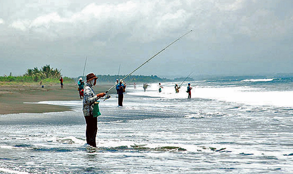 things to do in Bali - West Bali, Delod Berawah Village, with sloping black sand beach, a good site for fishing and swimming.