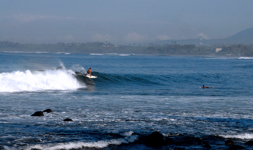 things to do in Bali - Medewi Beach, West Bali for great surfing, or just enjoy sunset over the ocean in a more secluded setting than Kuta.