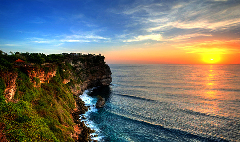 things to do in Bali - Uluwatu Temple perched atop the Uluwuatu cliffs is magnificent at sunrise.